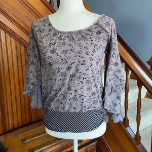 Grey floral and striped print top.